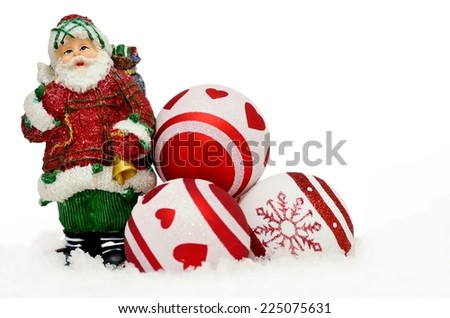 Christmas background with Santa and red baubles in snow on white - stock photo