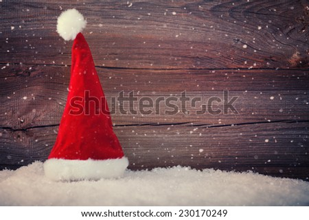 christmas background with santa hat and snow - stock photo