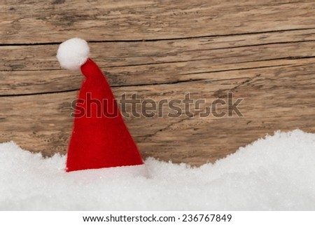 Christmas background with santa hat and snow for voucher, card, greetings - stock photo