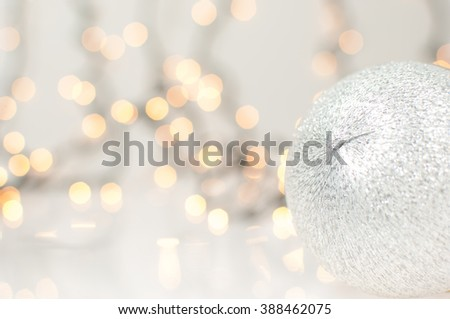 Christmas background with silver Christmas ball and lights. - stock photo