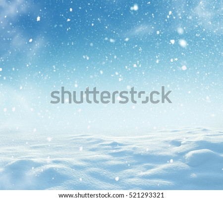 Christmas background with snow and blurred bokeh. New Year greeting card with copy-space.Winter landscape with falling snow