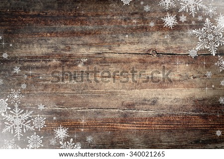 Christmas background with snowflakes and wooden texture - stock photo