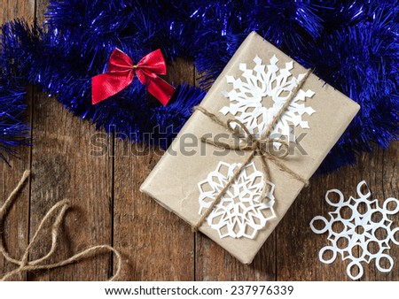 Christmas background with snowflakes dark wooden paper - stock photo