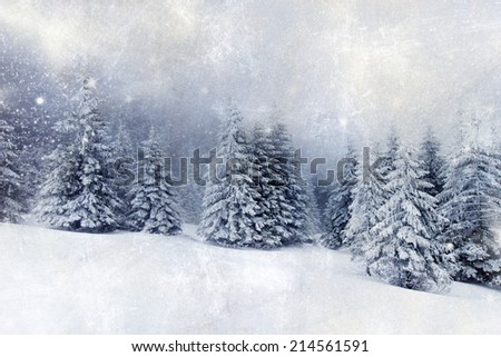 Christmas background with snowy fir trees - vintage photo - stock photo