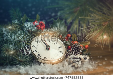 Christmas background with spruce and a clock.