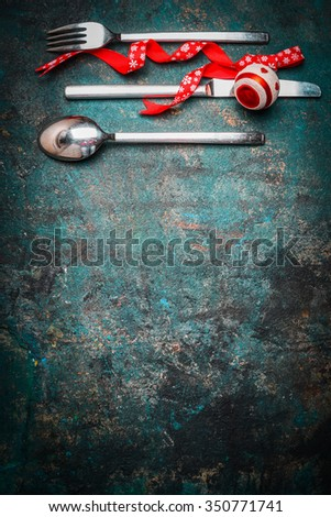 Christmas background with table setting and red ribbon and decoration for festive dinner, vertical - stock photo