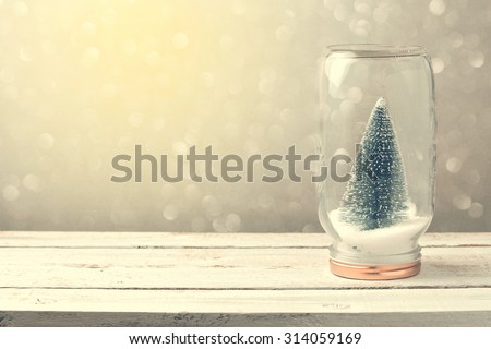 Christmas background with tree in jar and bokeh - stock photo