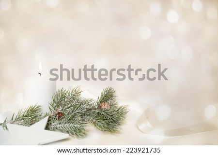 christmas background with white candle and branch of fir tree - stock photo