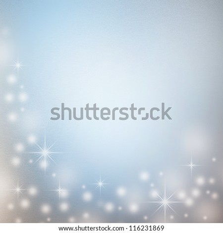 christmas background with white decorative snowflakes, sparkles in white and subtle blue colors and copy space for text - stock photo