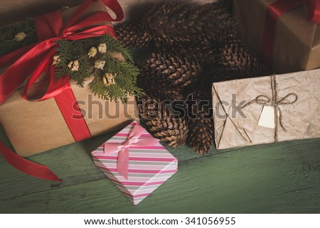 Christmas background with wooden toys, gifts and red ribbons