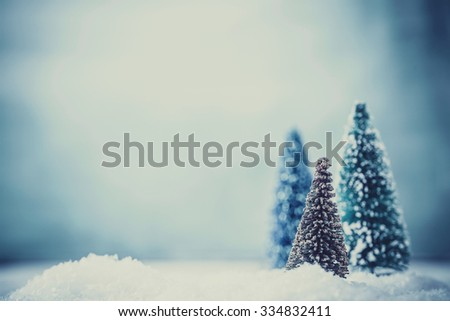 Christmas background. Xmas fir tree on snow. Greeting card - stock photo