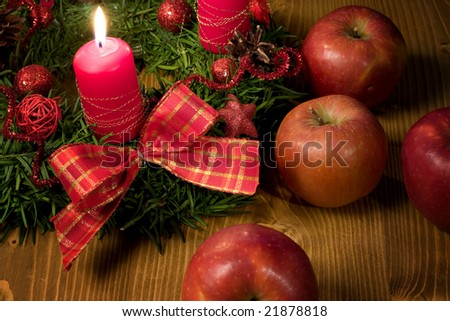 Christmas backgrounds - Christmas wreath with candle and apple