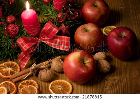 Christmas backgrounds - Christmas wreath with candle, apple and walnuts