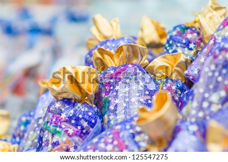 Christmas bags and boxes with candy sweets gifts in supermarket - stock photo