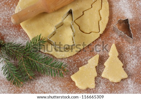 Christmas baking background dough, cookie cutters, rolling pin.