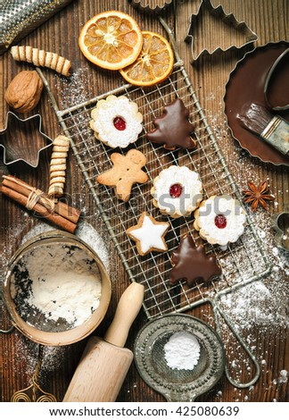 Christmas baking background with cookies, cookie cutters, spices and other ingredients - stock photo