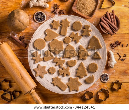 Christmas baking concept: dough, cutters and spices - stock photo
