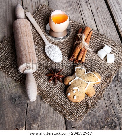 Christmas baking cookies with baubles  spices and empty cutting board abstract background - stock photo