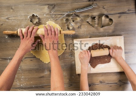 Christmas baking, mother and daughter together made - stock photo