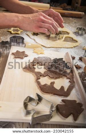 Christmas baking, prepare  human hand the cookies - stock photo