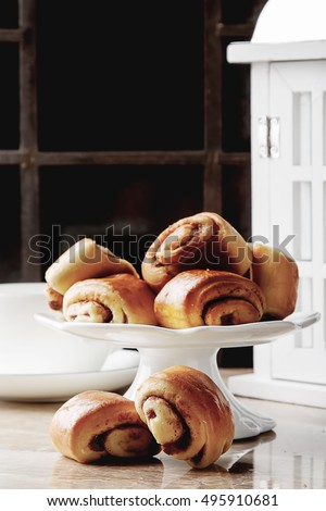 Christmas baking. Rolls with cinnamon. Bright stone background