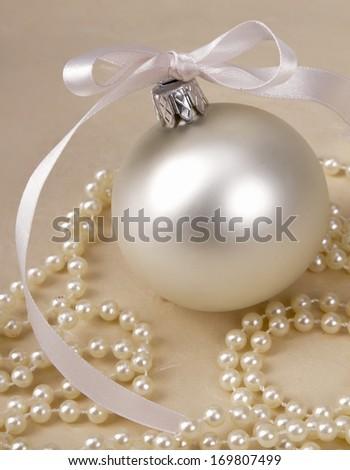 Christmas ball and beads - stock photo