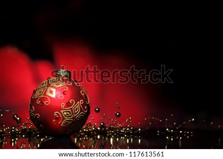 Christmas ball and beads on black background. - stock photo