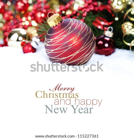 Christmas ball and Christmas tree with decorations (with sample text) - stock photo