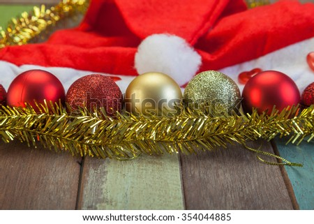 Christmas ball and decorations on wooden floor - stock photo