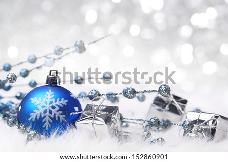 Christmas ball and giftbox on abstract background - stock photo