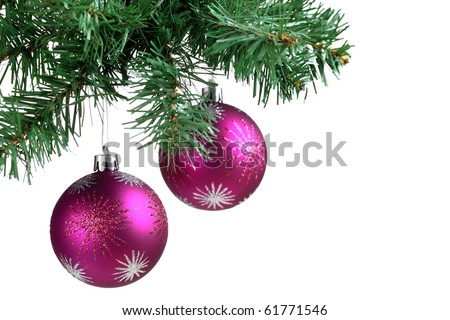 Christmas ball and green spruce branch . - stock photo