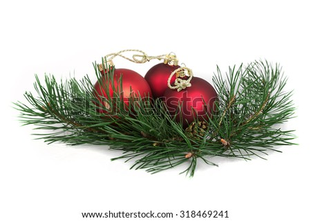 Christmas ball and green spruce branch, on white background - stock photo