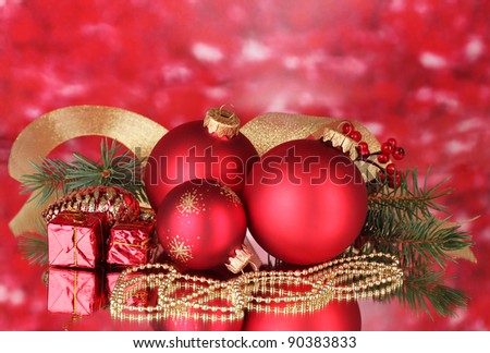 Christmas ball and green tree on red - stock photo