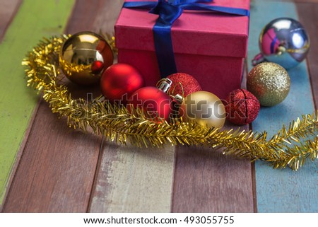 Christmas ball and pine tree with decoration on wooden floor