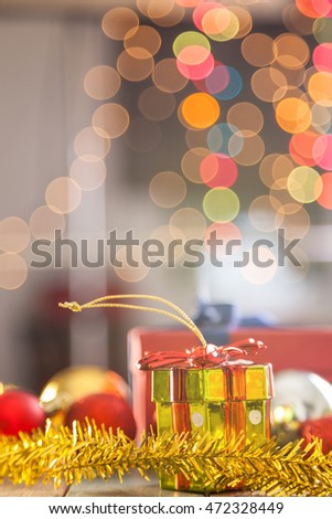 Christmas ball and red hat with decoration on bokeh wooden background