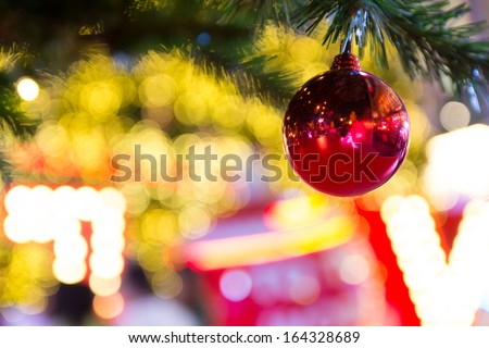 Christmas ball decoration against lights blurred background