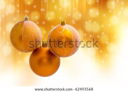 christmas ball decoration on yellow background - stock photo