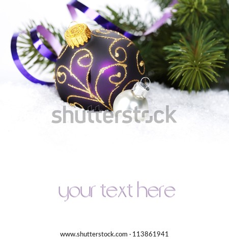 Christmas ball decoration with snow  and branch of Christmas tree (with sample text) - stock photo