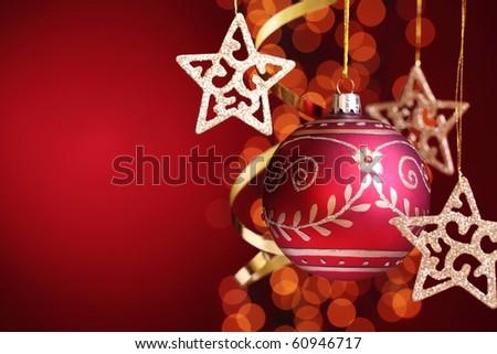 Christmas ball,gold stars over festive background. - stock photo
