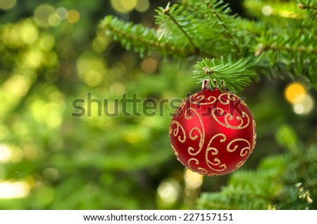 Christmas ball hanging on abstract lights background - stock photo