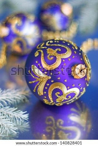 Christmas ball isolated on blue background cutout - stock photo