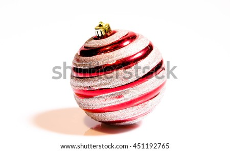 Christmas ball New Year's Eve decoration golden red shiny convolution lines bauble wintertime hanging adornment souvenir.  - stock photo