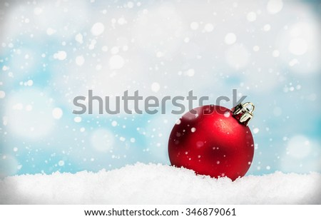 Christmas ball on a table in the snow. focus on Christmas tree ball - stock photo