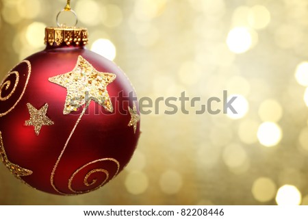 Christmas ball on abstract golden light background,Shallow Dof. - stock photo