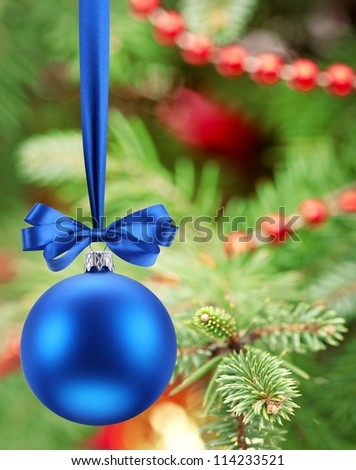 Christmas ball on fir branches. - stock photo