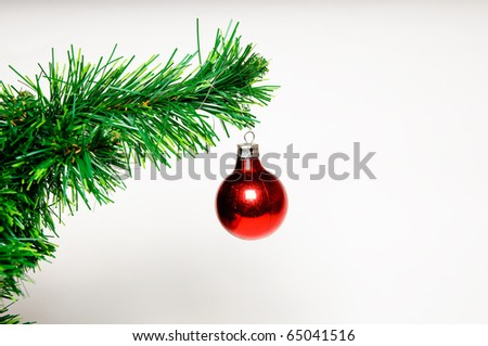 Christmas ball on green christmas tree isolated on white background - stock photo