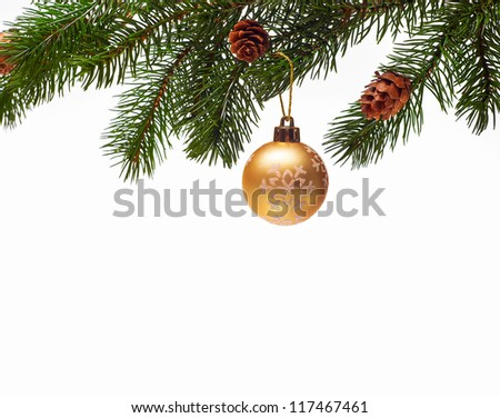 Christmas ball on green spruce branch - stock photo