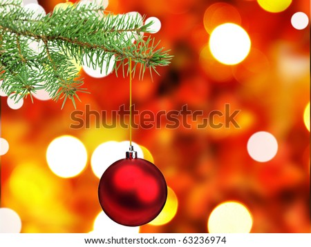 Christmas ball on green spruce branch with shiny blur background - stock photo