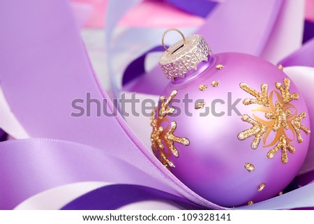 Christmas ball on ribbons.