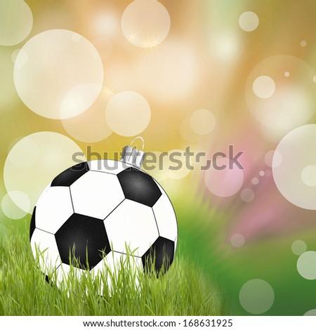Christmas ball on the grass - stock photo
